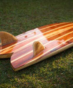A hollow wooden fish surfboard.